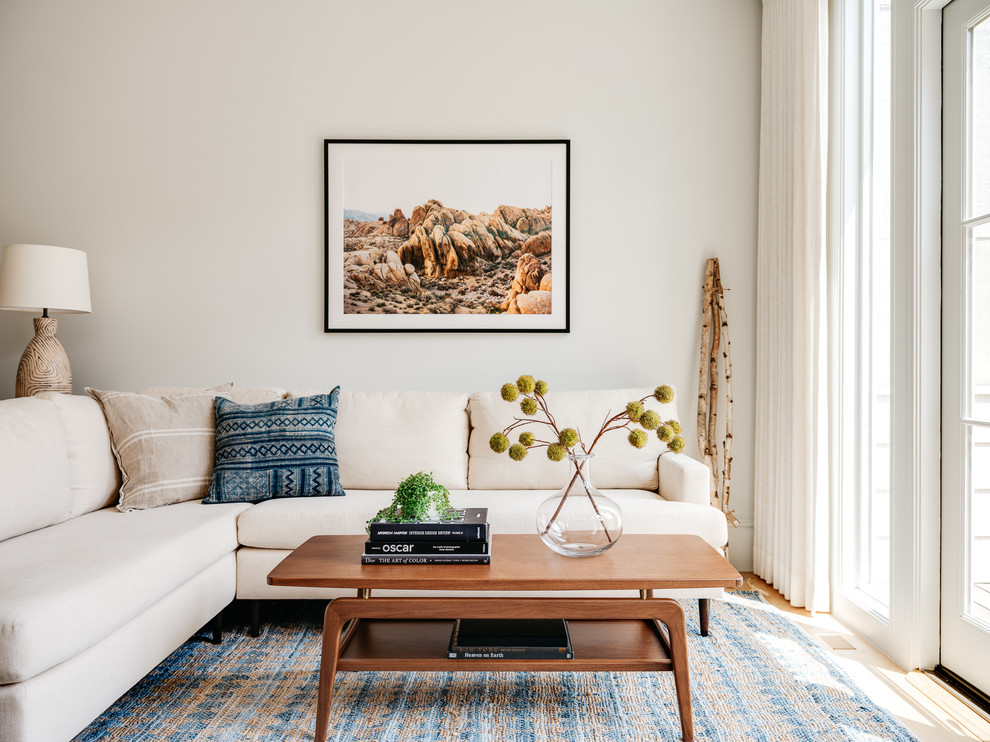 Inspiration for a scandinavian living room library remodel in San Francisco with white walls and no fireplace