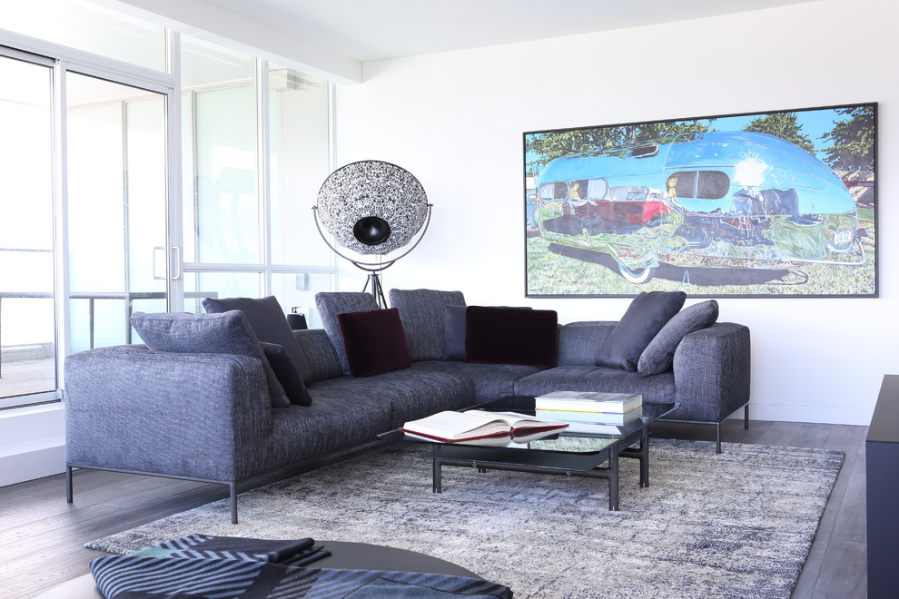 Inspiration for a large modern open concept medium tone wood floor living room remodel in Vancouver with a music area, white walls, a standard fireplace, a stone fireplace and a wall-mounted tv