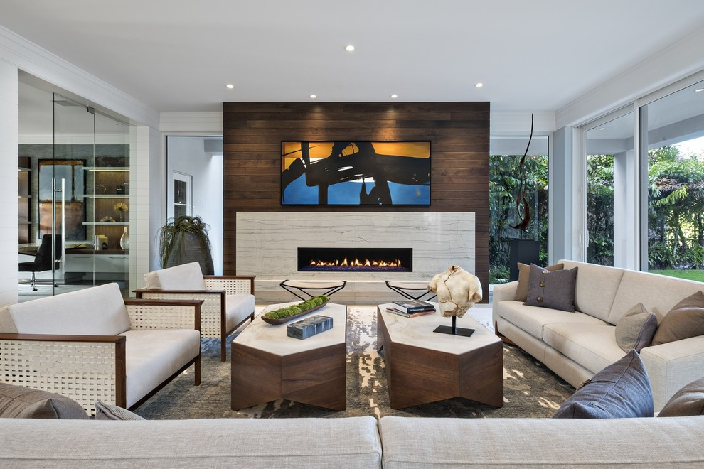 Huge trendy formal and enclosed living room photo in Miami with a ribbon fireplace and a stone fireplace