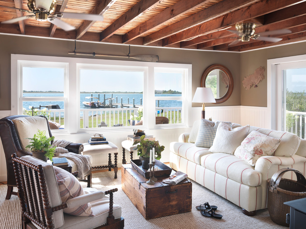 Living room - beach style living room idea in Providence with brown walls and no tv