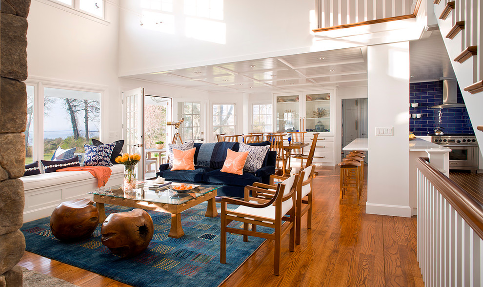 Inspiration for a coastal open concept medium tone wood floor and brown floor living room remodel in Bridgeport with white walls