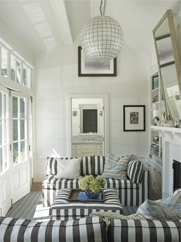 Inspiration for a beach style living room remodel in New York with white walls