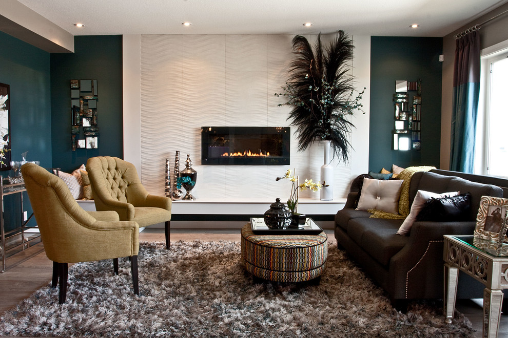 Living room - transitional living room idea in Calgary with blue walls and a ribbon fireplace