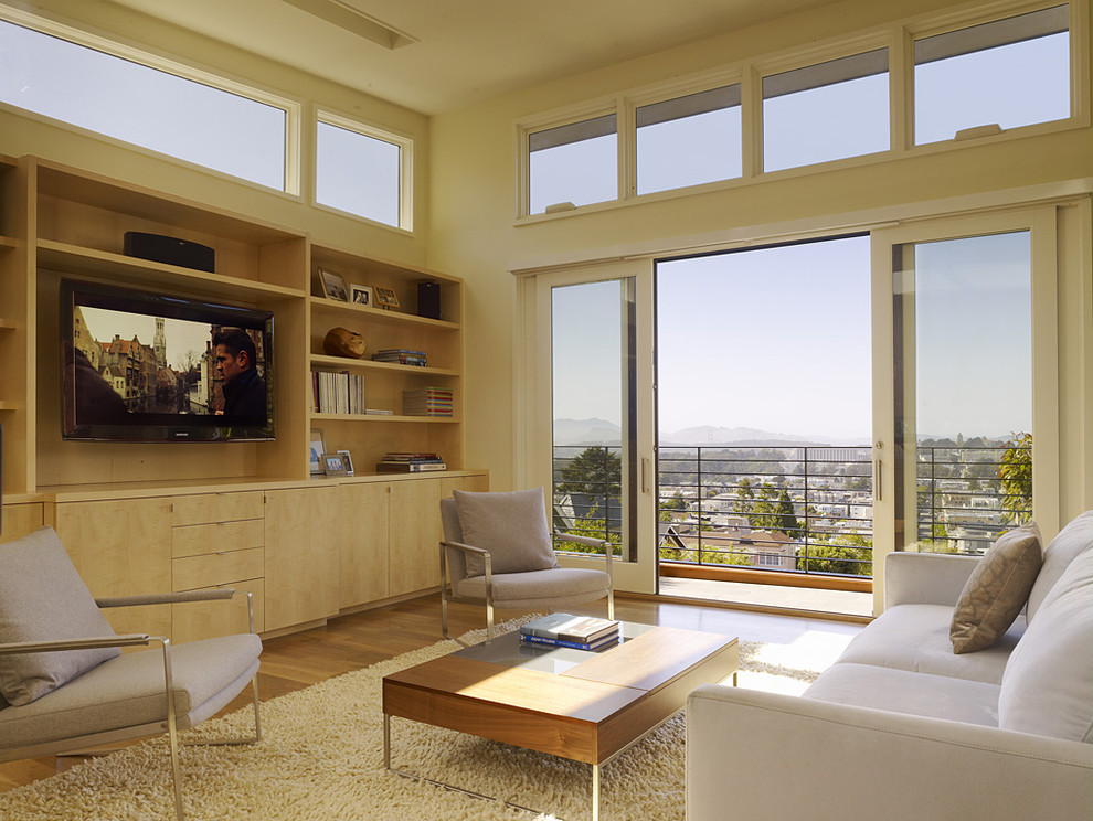 Minimalist living room photo in San Francisco with beige walls and a media wall