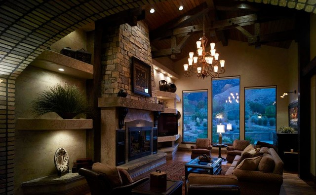 Inspiration for a large timeless formal and open concept medium tone wood floor living room remodel in Denver with beige walls, a standard fireplace, a stone fireplace and a tv stand