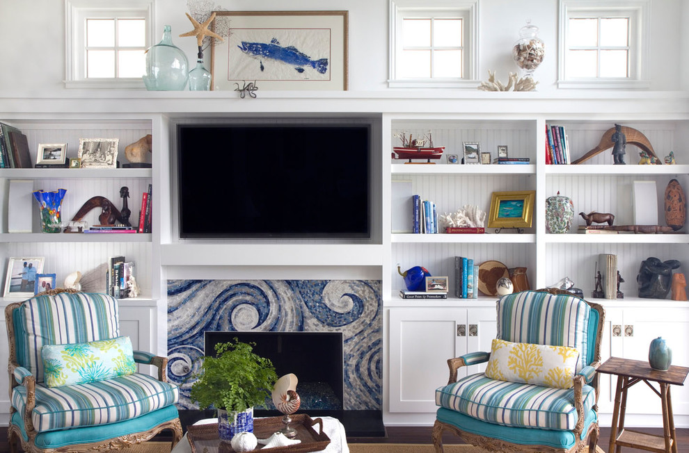 Beach style dark wood floor living room photo in San Diego with white walls, a standard fireplace, a tile fireplace and a wall-mounted tv