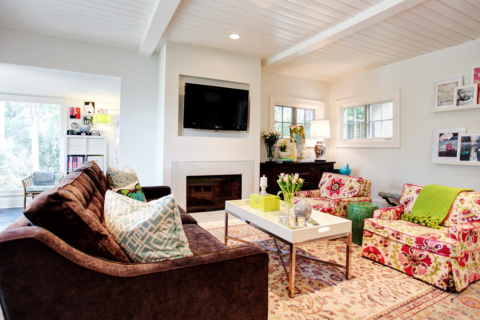 Inspiration for a transitional living room remodel in Los Angeles with a standard fireplace and a wall-mounted tv