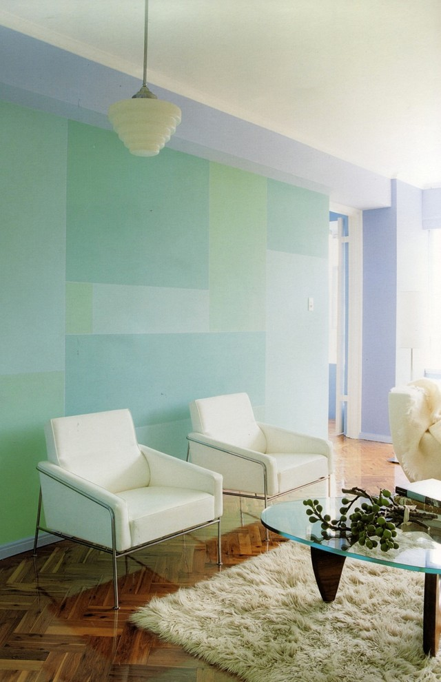 Example of a trendy medium tone wood floor living room design in Sydney with blue walls