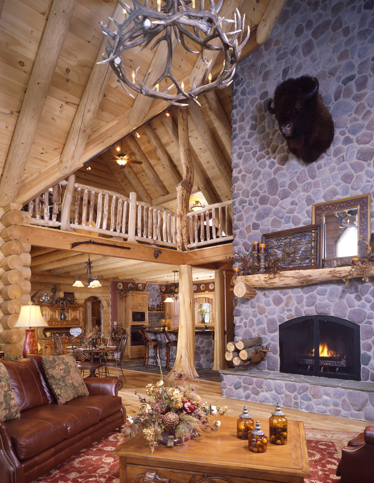 Mountain style living room photo in Cleveland with a standard fireplace, a stone fireplace and no tv