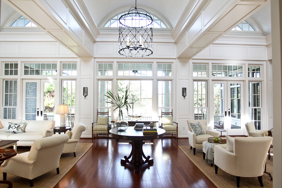 Example of a classic living room design in Charleston with white walls