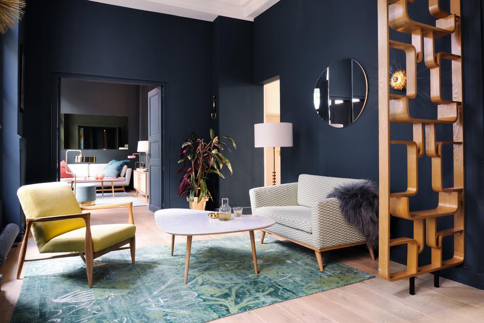 Living room - contemporary formal light wood floor living room idea in London with blue walls