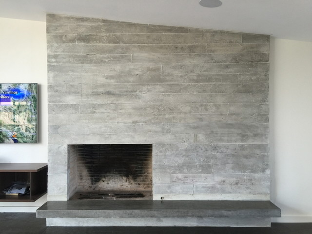 Concrete board form fireplace floating concrete hearth for Concrete mantels and hearths