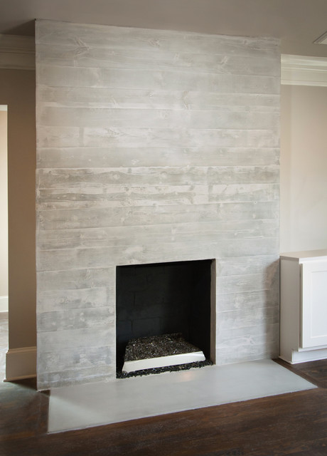 Concrete Board-Formed Fireplace Surround modern fireplaces