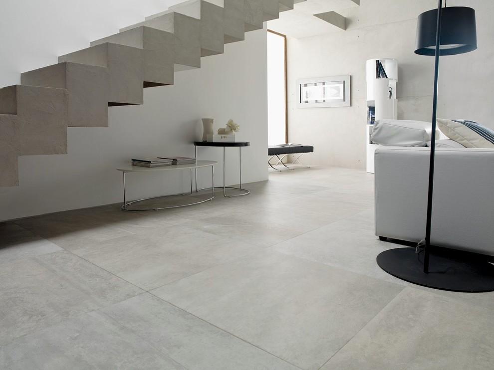 パースの広いインダストリアルスタイルのおしゃれなLDK (磁器タイルの床、白い壁、暖炉なし、テレビなし、フォーマル) の写真