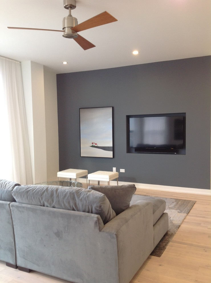Inspiration for a small contemporary open concept light wood floor living room remodel in Chicago with blue walls and a wall-mounted tv