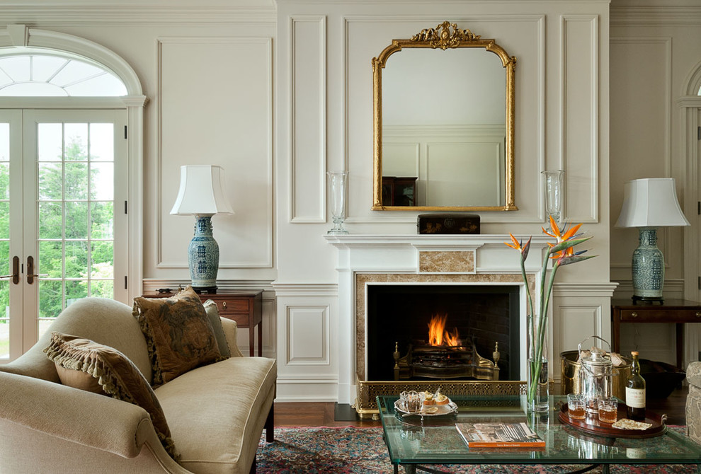 Inspiration for a timeless living room remodel in New York with white walls and a standard fireplace