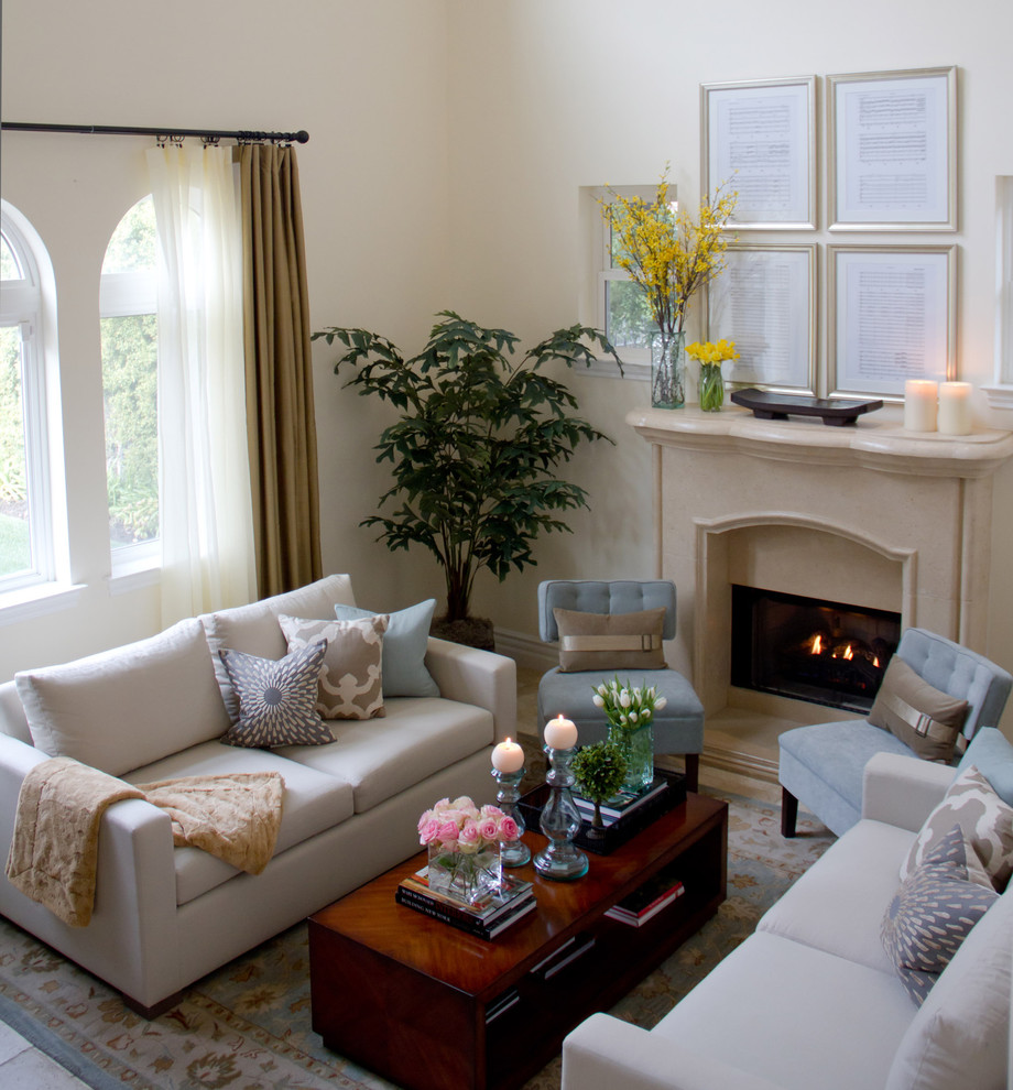 Example of a classic enclosed living room design in Los Angeles with a standard fireplace