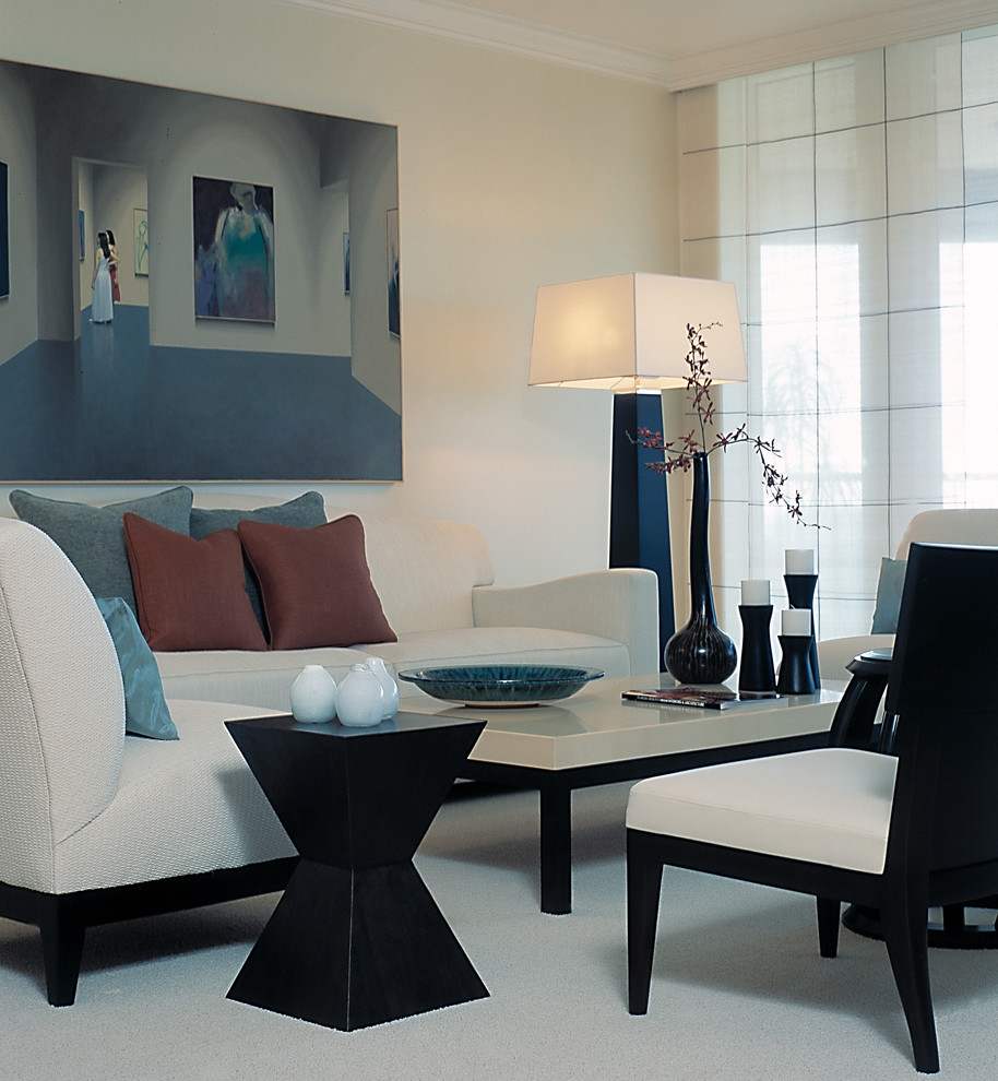 Example of a mid-sized trendy open concept carpeted living room design in Miami with white walls, no fireplace and no tv
