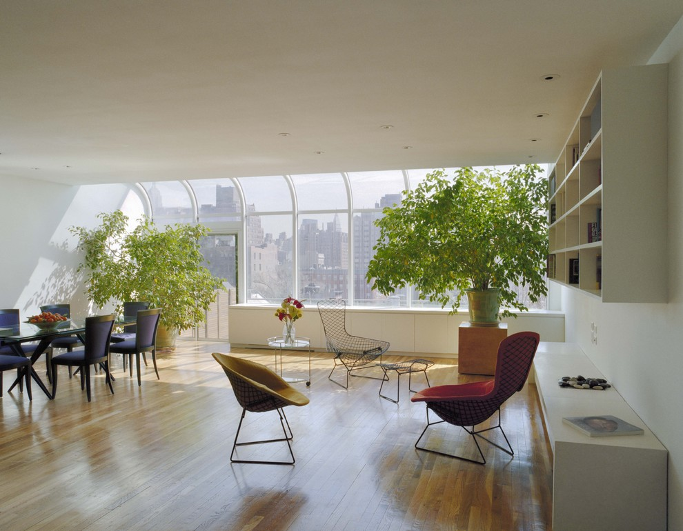 Large minimalist open concept light wood floor living room photo in New York with white walls and no fireplace