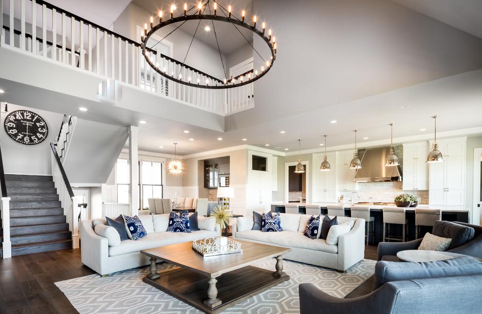 Living room - farmhouse open concept dark wood floor and brown floor living room idea in Other with beige walls