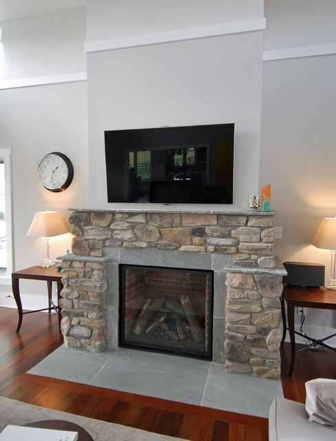Contemporary farmhouse stone fireplace and wood floors for Modern farmhouse fireplace