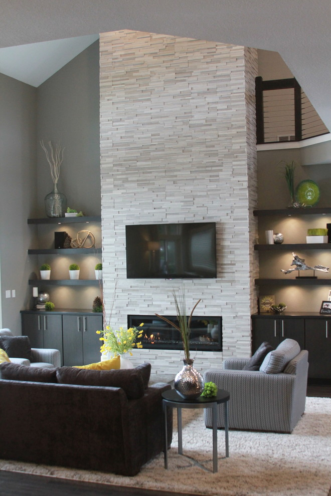 Mid-sized trendy formal and open concept dark wood floor and brown floor living room photo in Milwaukee with gray walls, a ribbon fireplace, a stone fireplace and a wall-mounted tv