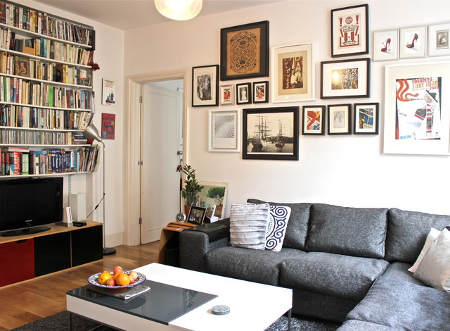 Example of a trendy living room library design in London
