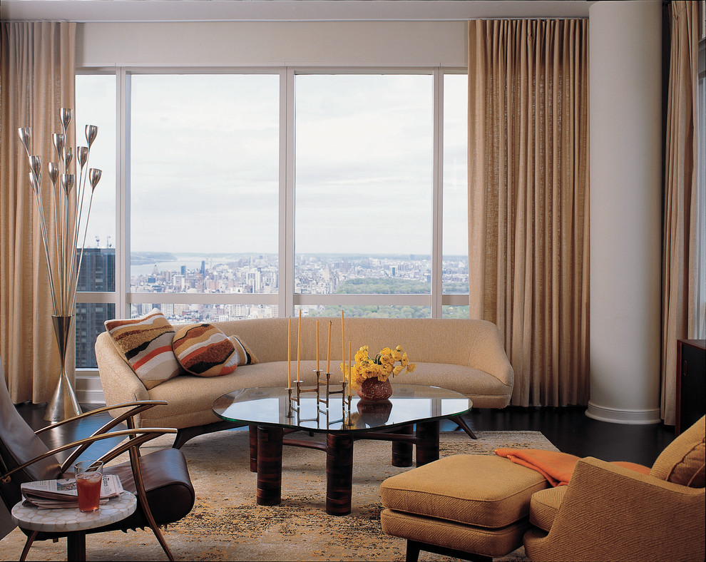 Example of a trendy living room design in New York with white walls