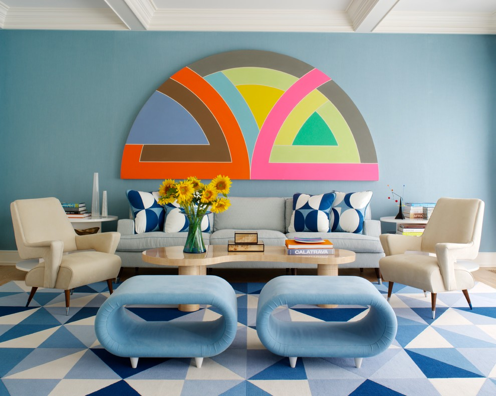 Trendy formal living room photo in New York with blue walls