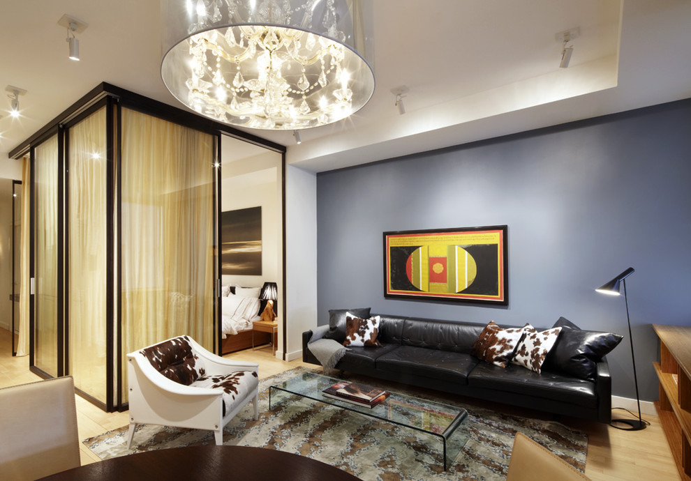 Example of a trendy light wood floor living room design in New York with blue walls