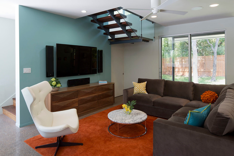 Inspiration for a contemporary living room remodel in Austin with blue walls and a wall-mounted tv