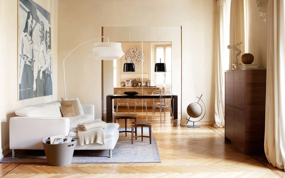 Example of a trendy light wood floor living room design in Other with beige walls and no fireplace