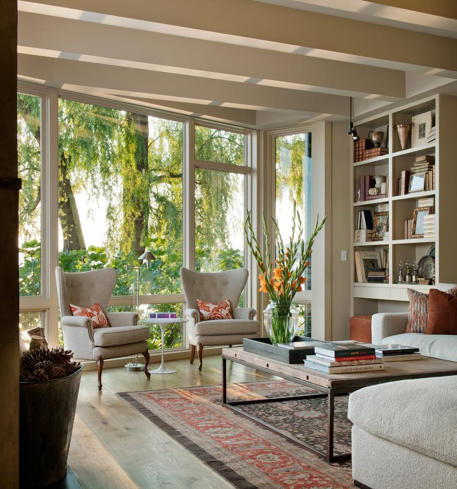 Elegant medium tone wood floor living room photo in Seattle