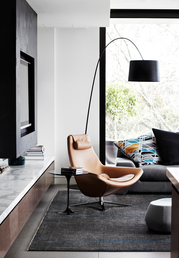 Example of a mid-sized trendy open concept living room design in Melbourne with white walls and a media wall
