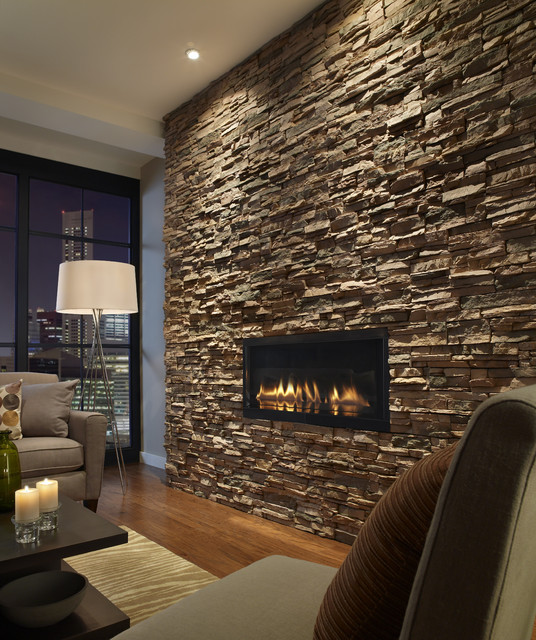 Example of a trendy living room design in New York with a stone fireplace