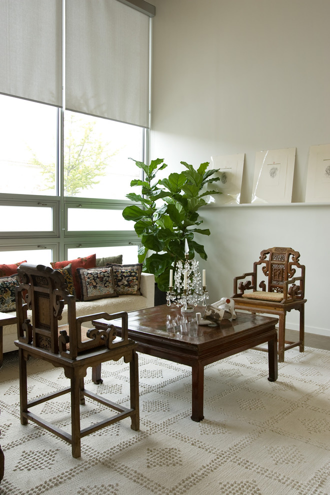 Trendy living room photo in Birmingham with white walls