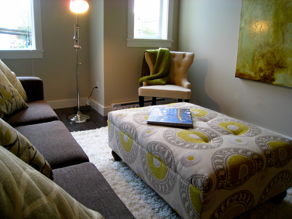 Example of a trendy living room design in Vancouver with beige walls