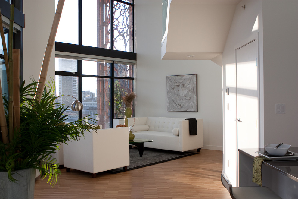 Living room - contemporary living room idea in Vancouver with white walls