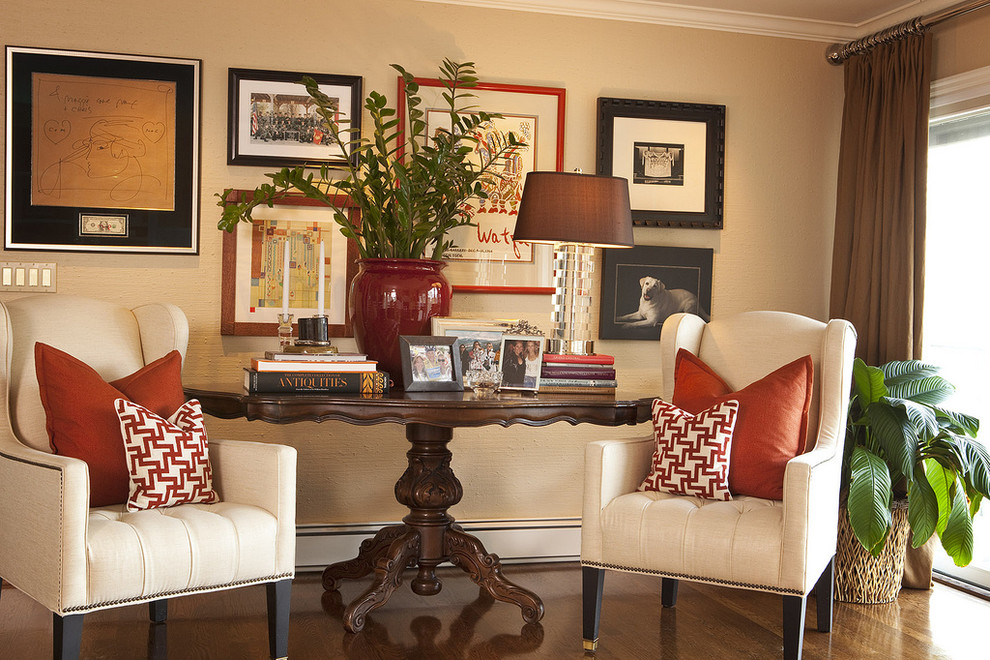 Trendy dark wood floor living room photo in Portland with beige walls