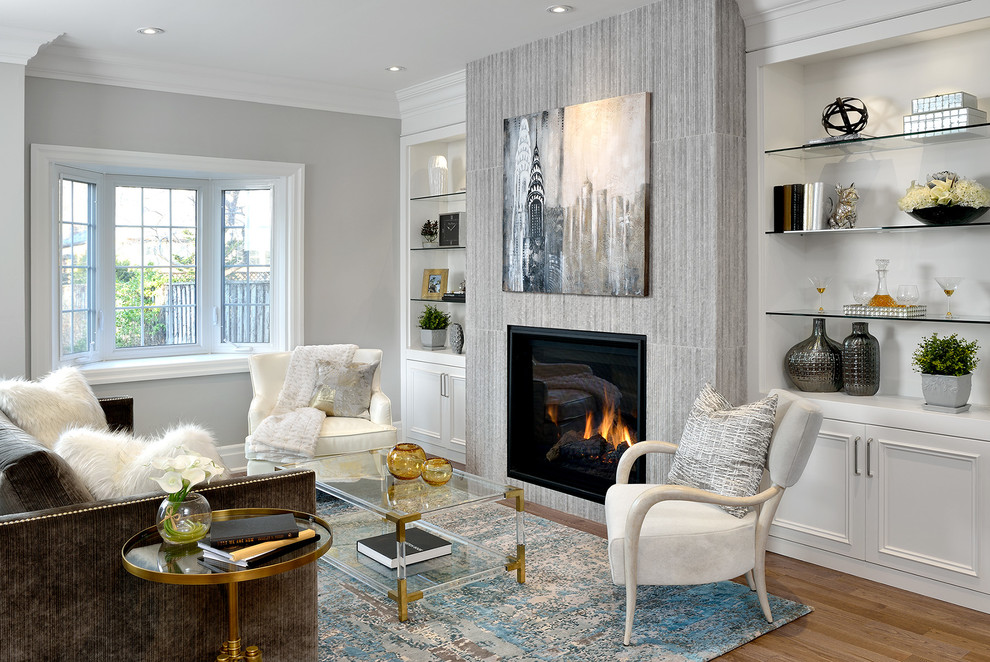 Example of a trendy formal light wood floor living room design in Toronto with white walls and a standard fireplace