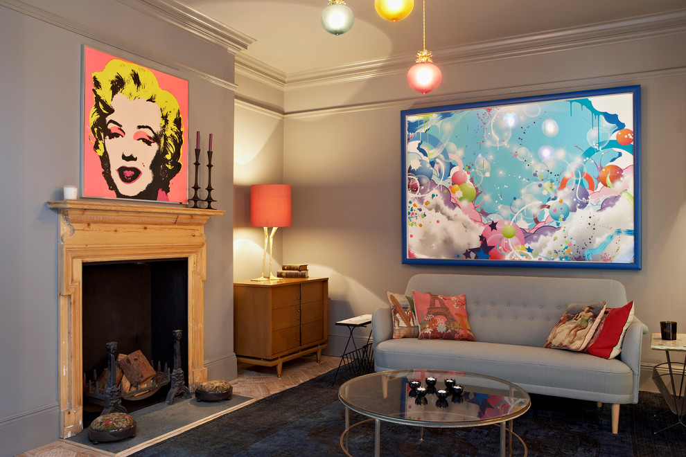 Example of a trendy formal living room design in London with gray walls, a standard fireplace and no tv