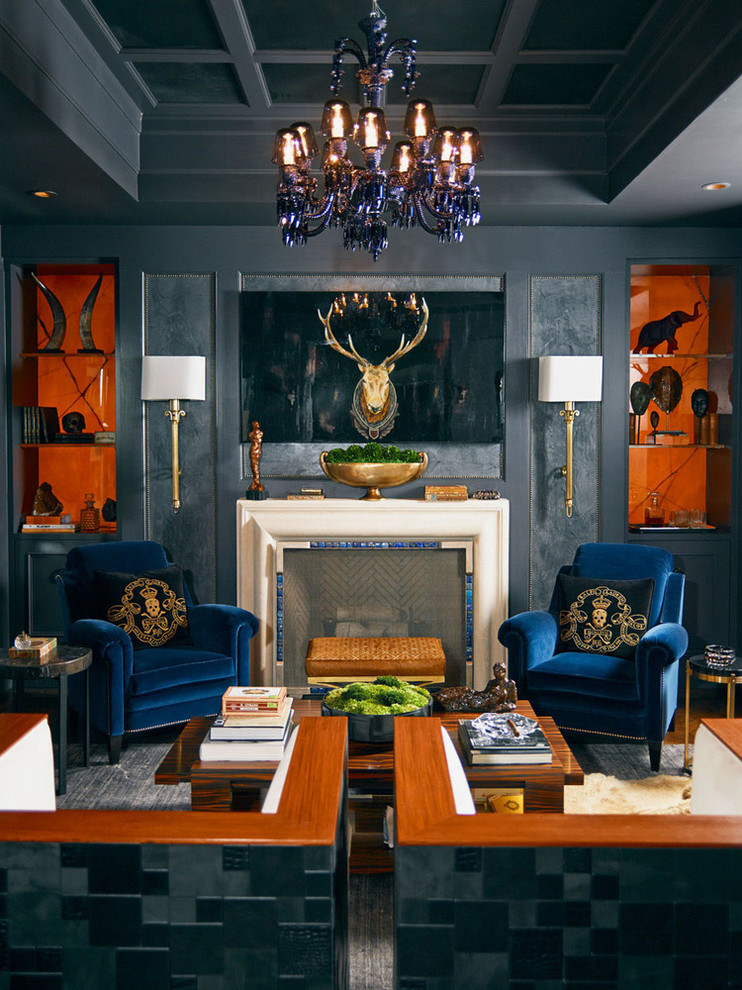 Example of a mid-sized trendy enclosed medium tone wood floor living room library design in Atlanta with gray walls, a standard fireplace, a stone fireplace and no tv