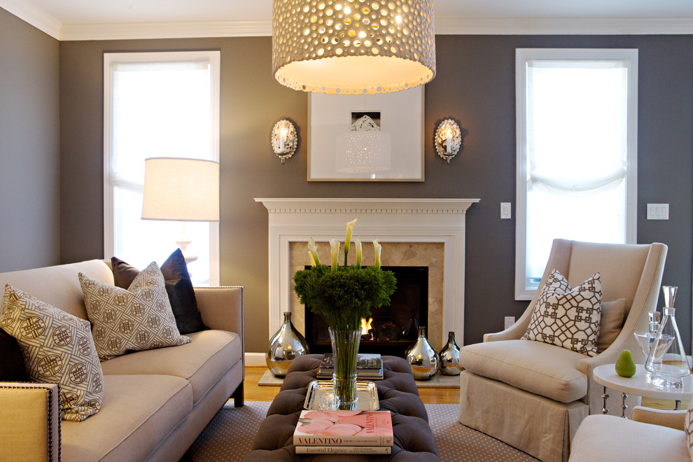 Example of a transitional living room design in Raleigh with gray walls and a standard fireplace