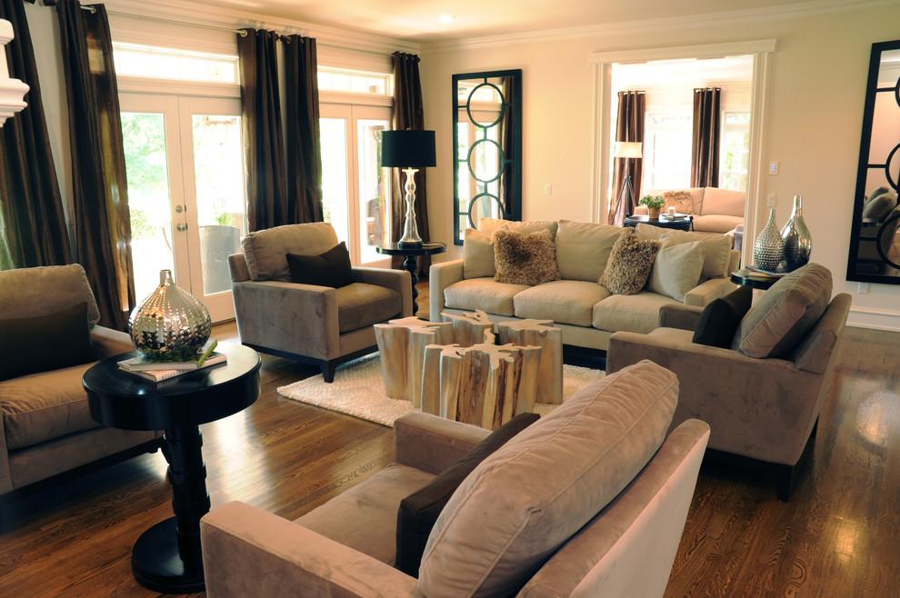 Large trendy dark wood floor living room photo with beige walls