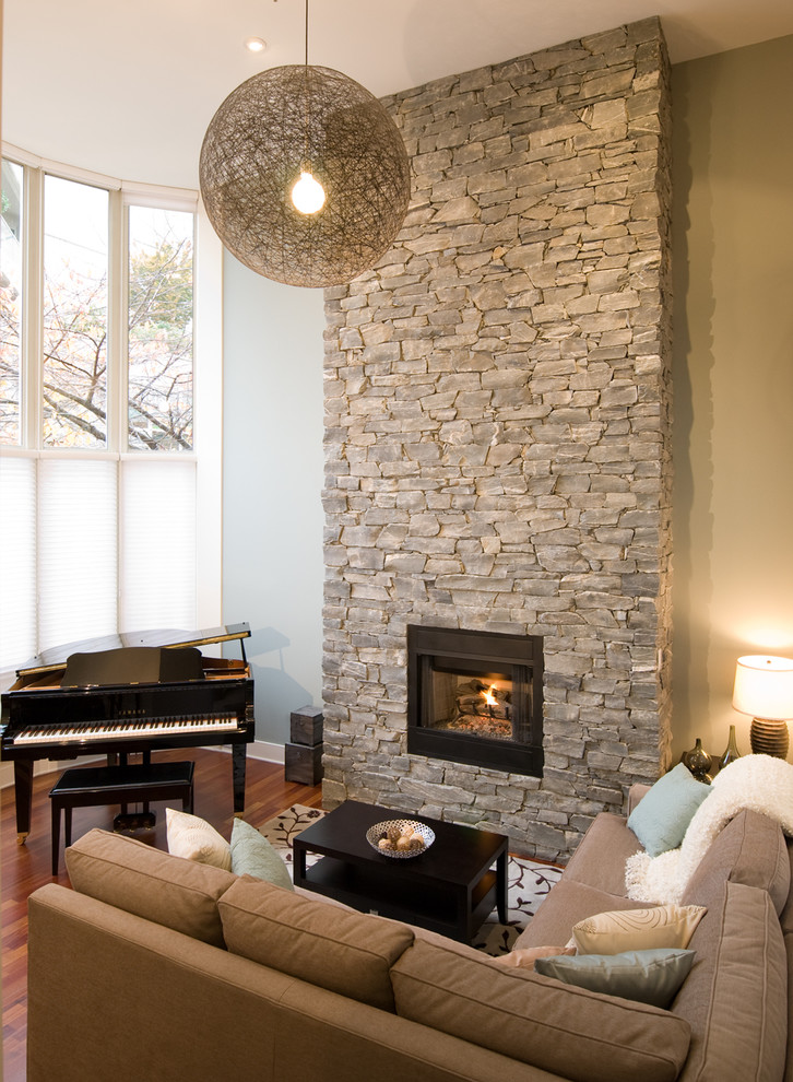 Living room - contemporary living room idea in Vancouver with a stone fireplace
