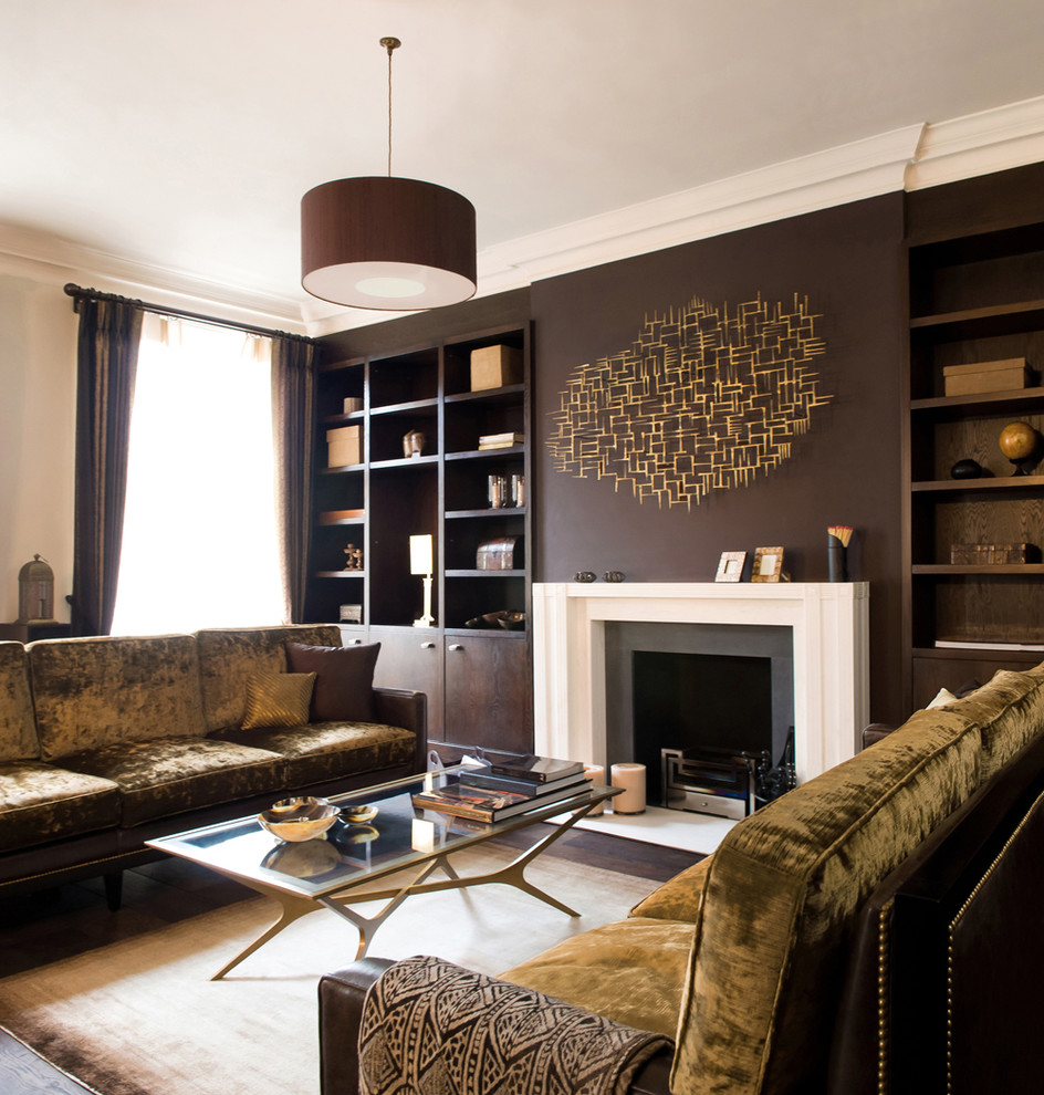 Living room library - contemporary living room library idea in London with brown walls, a standard fireplace and no tv