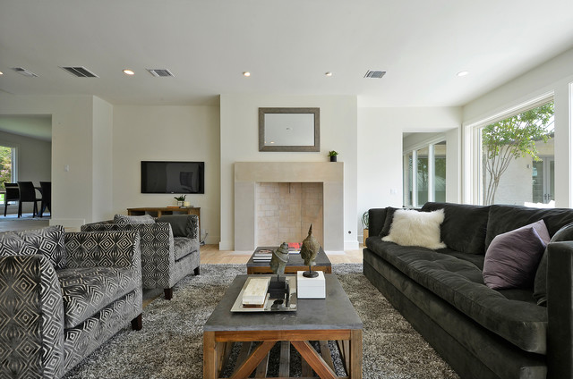 Inspiration For A Contemporary Living Room Remodel In Austin With A  Standard Fireplace And A Wall