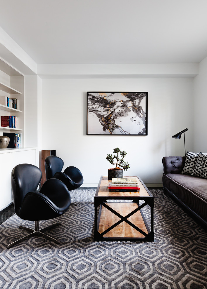 Inspiration for a small contemporary enclosed living room library remodel in Melbourne with white walls