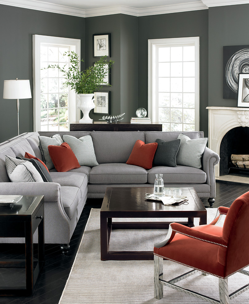Example of a mid-sized trendy formal and open concept painted wood floor and black floor living room design in New York with gray walls, a standard fireplace, a plaster fireplace and no tv