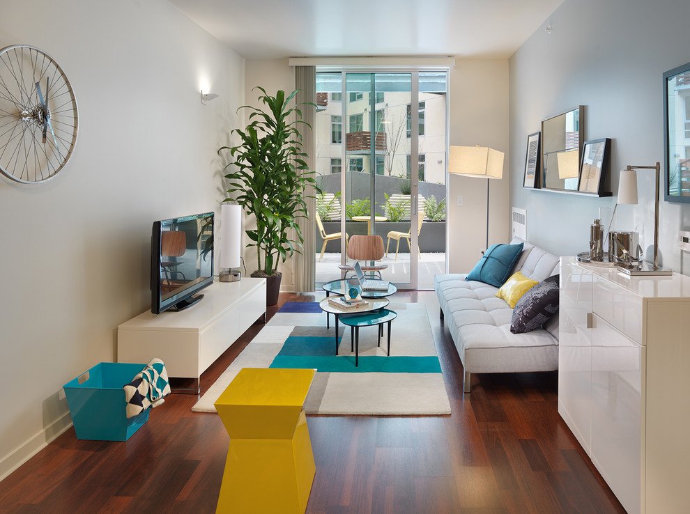 Inspiration for a contemporary medium tone wood floor living room remodel in San Francisco